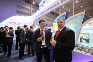 AXCEN GM Paul Grieve at the AXCEN Pavilion in China with the Trade Minister